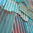 Artists Express Themselves on Corrugated Sheet Metal Fences